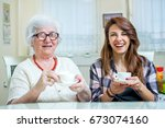 portrait of a grandma and her...   Shutterstock . vector #673074160