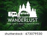 wanderlust travel logo on green ... | Shutterstock . vector #673079530