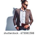 portrait of handsome fashion... | Shutterstock . vector #673081588