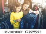 cheerful people are buying... | Shutterstock . vector #673099084