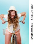 Small photo of Young active woman girl riding bike bicycle. Healthy lifestyle and recreation leisure activity. Studio shot.