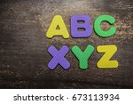 Small photo of Vintage school desk with composition of colorful letters - Concept of studying and learning ABC XYZ. alpha and omega idea, sign, symbol, concept of alphabet. education background