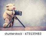 teddy bear photographer with... | Shutterstock . vector #673135483