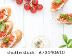 flat lay with bruschettas with... | Shutterstock . vector #673140610
