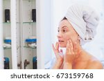 middle aged woman applying... | Shutterstock . vector #673159768