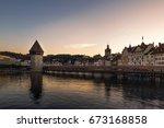 chapel bridge and fortress in... | Shutterstock . vector #673168858