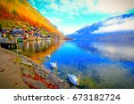 white swan in hallstatt sea. | Shutterstock . vector #673182724