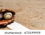 baseballs in a glove in the... | Shutterstock . vector #673199959