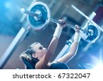 young woman weight training.... | Shutterstock . vector #67322047