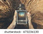 Top view on hands holding retro rustic medium format camera. Mockup with amazing landscape