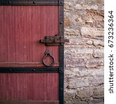 forged handle on the door. old...   Shutterstock . vector #673236364