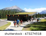 Small photo of Banff. Alberta. Canada. July 4 2017. Visitors were busy buying souvenir from the Cave and Basin visitor center.