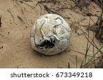 An Old Torn Soccer Ball Thrown...