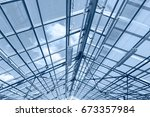 glass ceiling of contemporary... | Shutterstock . vector #673357984