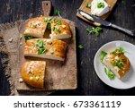 homemade italian focaccia bread.... | Shutterstock . vector #673361119