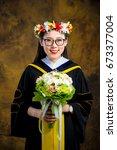 chinese girl in graduation... | Shutterstock . vector #673377004