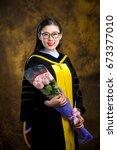chinese girl in graduation... | Shutterstock . vector #673377010