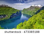 geiranger fjord seen from eagle ... | Shutterstock . vector #673385188