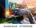 worker welder pipe welding with ... | Shutterstock . vector #673385668