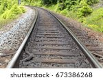 a line of rails with wooden...   Shutterstock . vector #673386268
