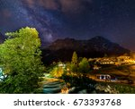 starry night in grindelwald you ... | Shutterstock . vector #673393768