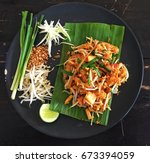 fried noodle thai style  pad... | Shutterstock . vector #673394059