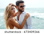 romantic couple on the beach | Shutterstock . vector #673409266