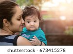 young indian mother with her... | Shutterstock . vector #673415278