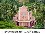 Small photo of Beautiful view of Our Lady of Dolours chapel surrounded by greenery of coconut palms at Bishop's House, Mangalore, Karnataka, India
