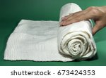 hand is holding a white silk... | Shutterstock . vector #673424353