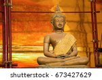 little golden buddha statue... | Shutterstock . vector #673427629