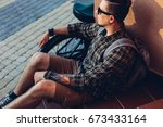 young man in sunglasses rests... | Shutterstock . vector #673433164