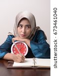 young muslim woman with book... | Shutterstock . vector #673461040