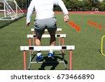 a high school male athlete... | Shutterstock . vector #673466890