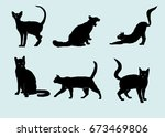 Stock vector silhouettes of cats 673469806