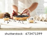 Man Prepares A Blueberry Pie...