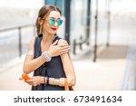 Young Woman Applying Sunscreen...