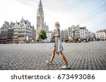 young woman tourist walking on... | Shutterstock . vector #673493086