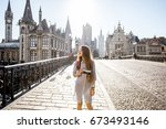 Young Woman Tourist Walking Th...