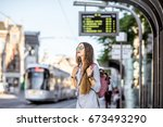 young woman standing on the... | Shutterstock . vector #673493290