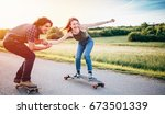 skateboarding couple having fun ... | Shutterstock . vector #673501339