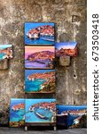 Small photo of DUBROVNIK/CROATIA - 28 JUNE 2018: Colorful paintings of Dubrovnik old town exposed to be sold on the city walls. Dubrovnik is Croatia's most important touristic destination. Credit: Dino Geromella