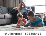 happy young family playing... | Shutterstock . vector #673506418