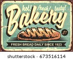 bakery shop sign with hand... | Shutterstock .eps vector #673516114