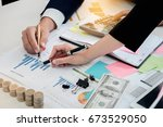 young businessman and partner... | Shutterstock . vector #673529050