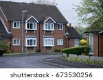 row of new english houses | Shutterstock . vector #673530256