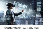 experiencing virtual reality....   Shutterstock . vector #673537753