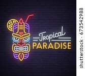 tropical tiki mask neon sign.... | Shutterstock .eps vector #673542988