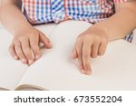 the blind boy is reading a book ... | Shutterstock . vector #673552204