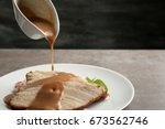 pouring tasty turkey gravy onto ... | Shutterstock . vector #673562746